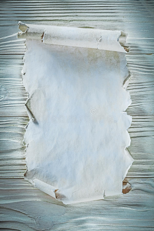 Vintage crumpled paper roll on wooden board.  stock photography