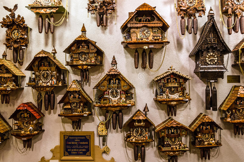 Vintage cuckoo clocks in shop, Bavaria, Munich, Germany royalty free stock images