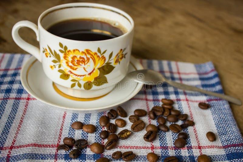 Vintage cup of black coffee stock image