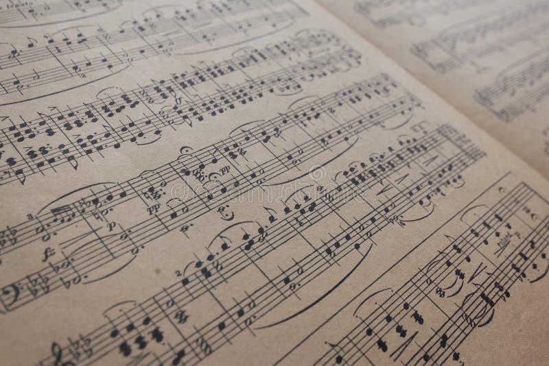 Vintage da folha de música - notas velhas da música imagens de stock