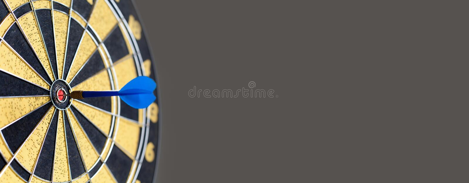 Vintage darts game success hitting target aim goal achievement. Blue Dart in bull`s eye. copy space. soft focus royalty free stock image