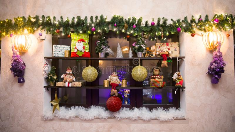 Vintage decorative shelf with Christmas decorations on the wall. Holiday concept stock images