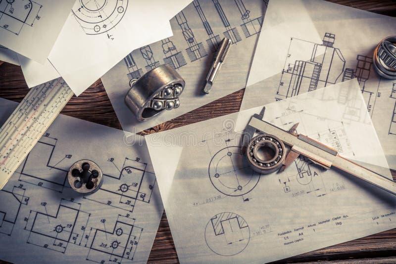 Vintage designer desk of mechanical parts stock photography