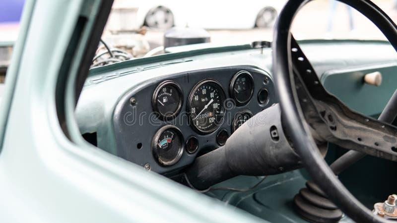 Vintage details inside  old hot rod car. Hot rod machine control sensors stock image