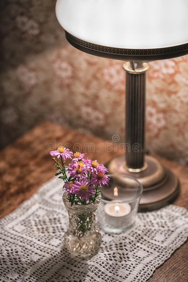 Free Vintage Details Of Vase With Flowers On The Wooden Table And Lamp Stock Photography - 101947702