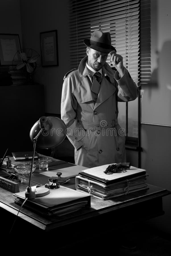 Vintage detective standing in his office royalty free stock photos