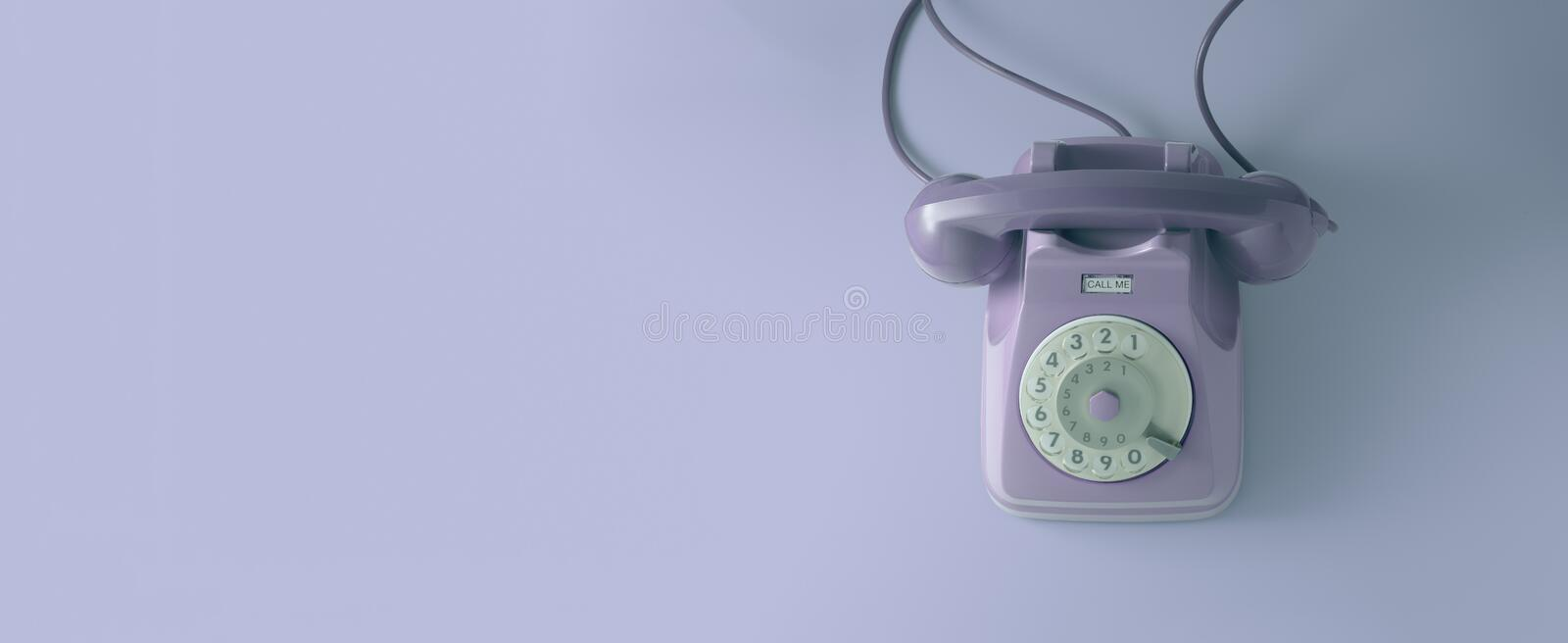 A vintage dial telephone with violet background. A violet vintage dial telephone with violet background royalty free stock image