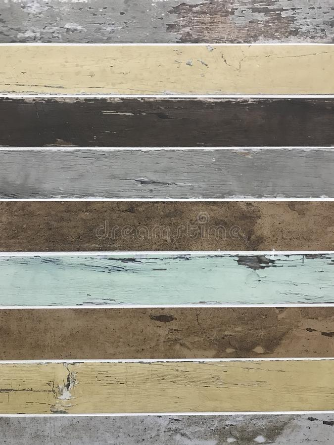 Vintage distressed colored wood slats background texture royalty free stock image