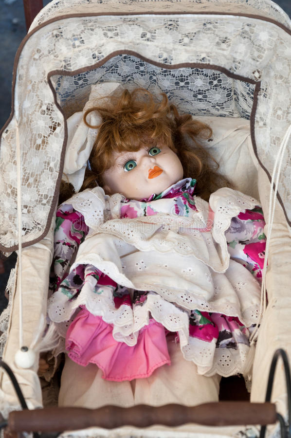 Vintage doll in cradle stock photos