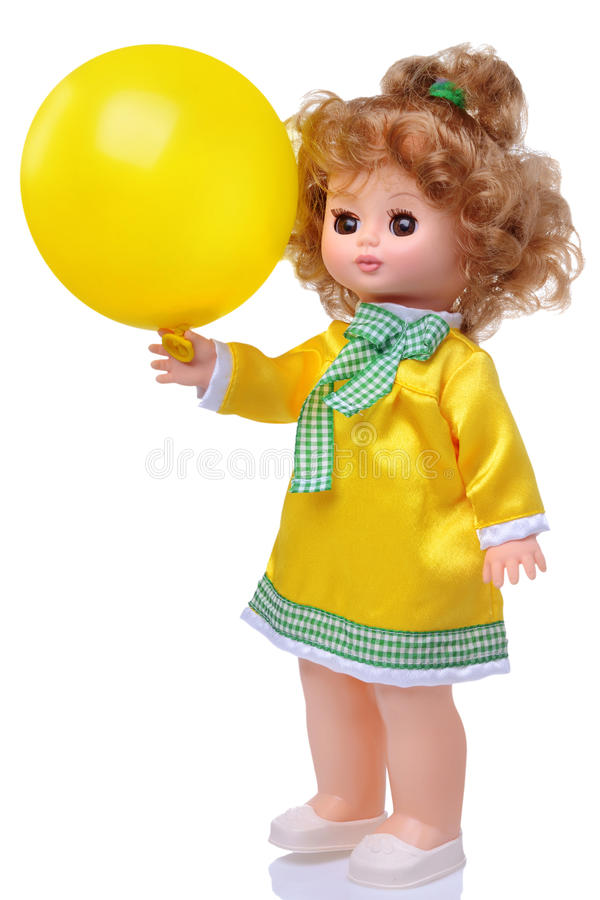 Vintage doll in yellow dress with baloon. Isolated on white royalty free stock images