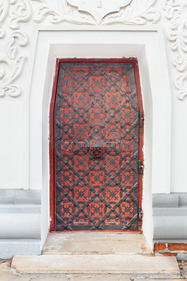 Vintage door. Vintage red metal door with a knock in the centre stock photography