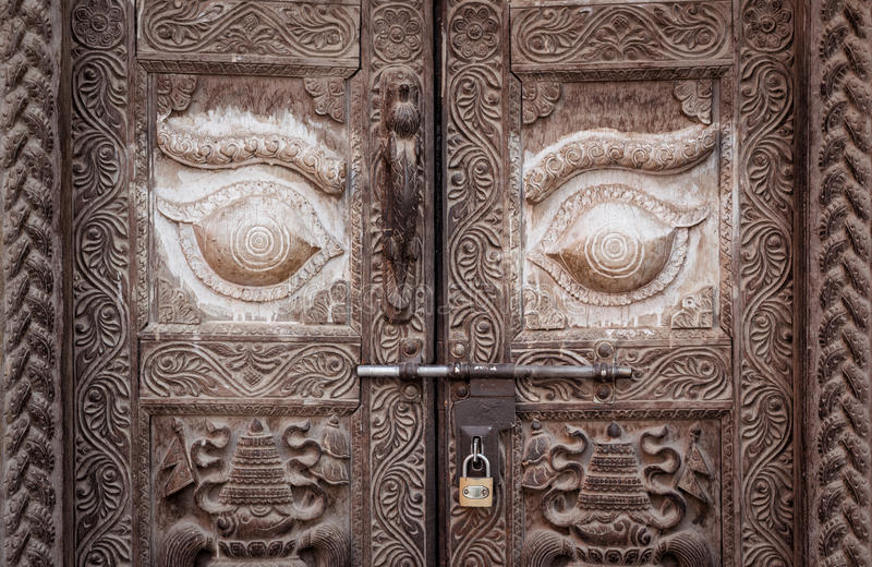 The vintage door in Nepalese style. The wood door made by Nepalese style in Kathmandu, Nepal stock photo