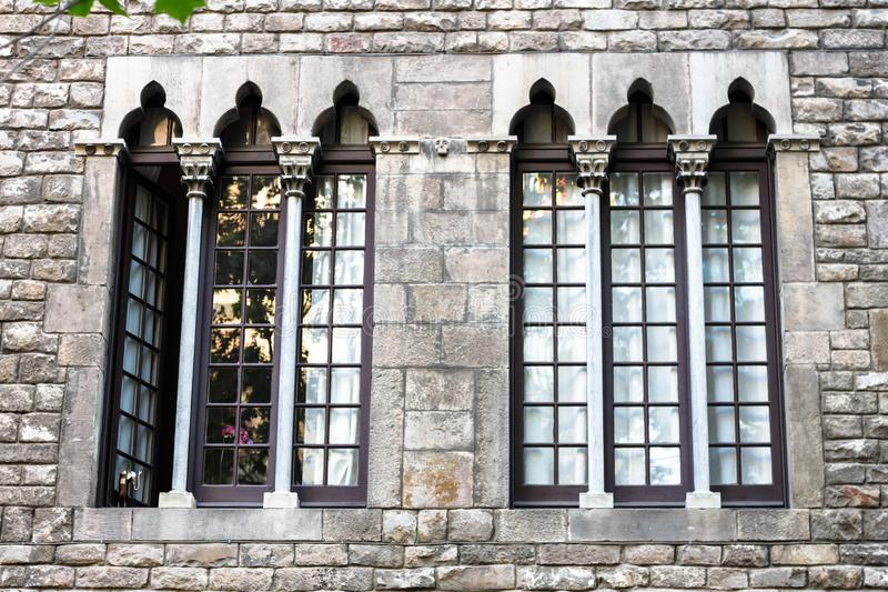 Vintage door and window on the facade of an old stone wall royalty free stock photography