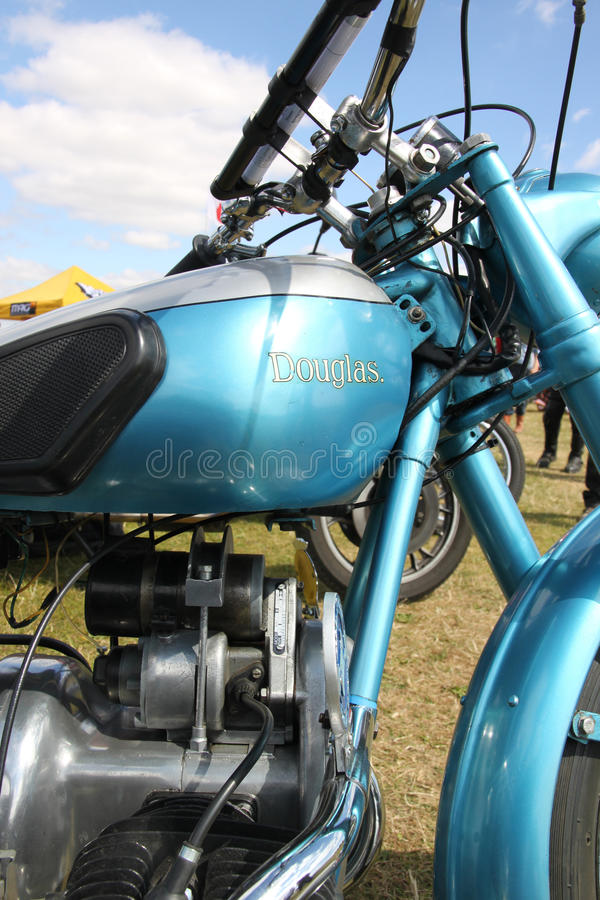 Vintage Douglas Dragonfly motorcycle. Vintage Douglas Dragonfly motorcycle in turquoise blue showing petrol tank and engine stock photos