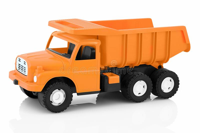 Vintage dump truck isolated on white background with shadow reflection. Plastic child toy on white backdrop. royalty free stock photo