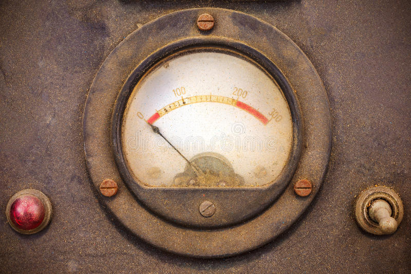 Vintage dusty volt meter in a metal casing stock image