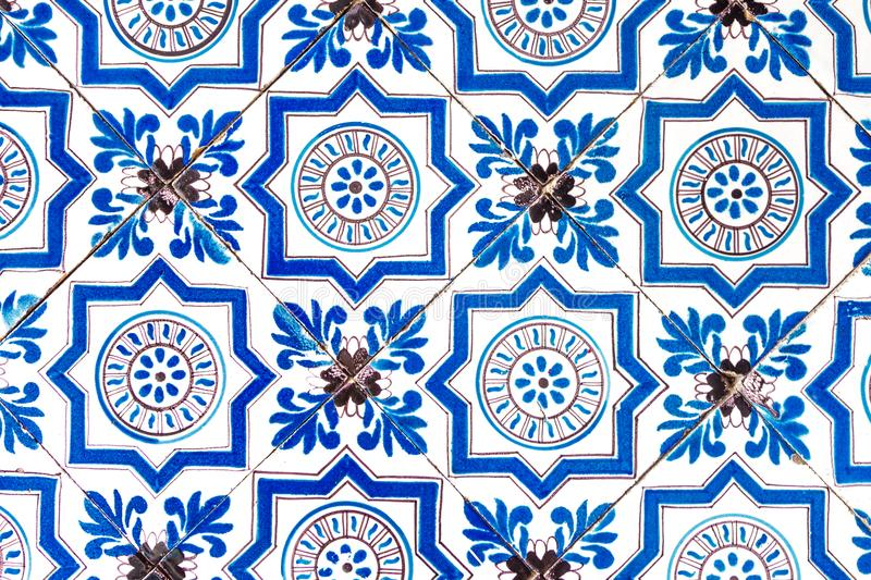 Holland tile dutch pattern old bright multicolored retro painting ornament vintage blue white. Vintage dutch tile with old pattern. Tiled wall with a colorful royalty free stock image