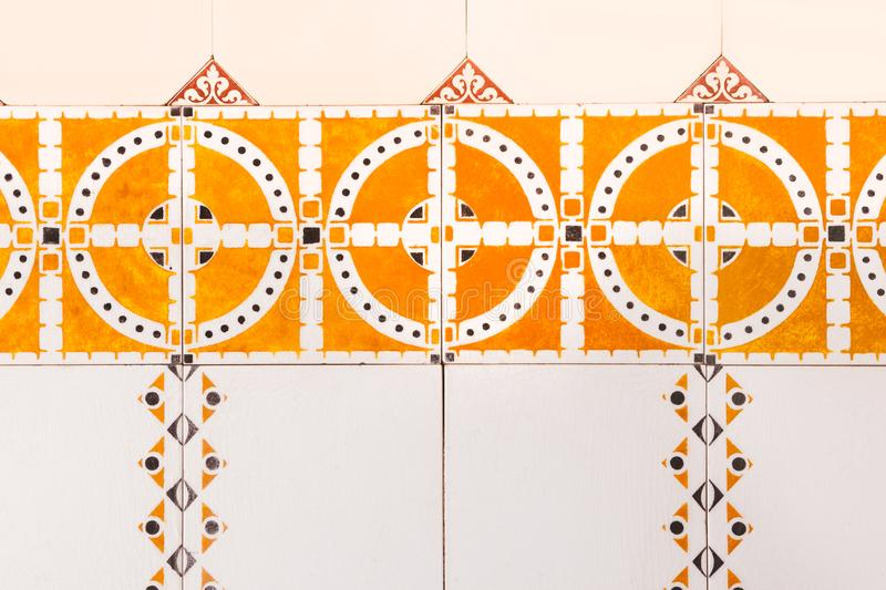 Holland tile dutch pattern old bright multicolored retro painting ornament vintage orange brown. Vintage dutch tile with old pattern. Tiled wall with a colorful royalty free stock photos