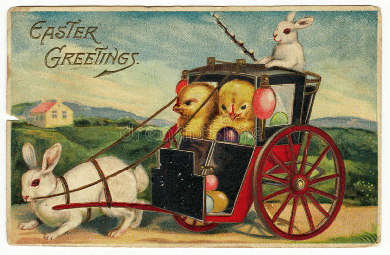 Vintage Easter Greetings Postcard. A vintage Easter postcard from 1910 featuring a rabbit pulling a coach with baby chicks inside