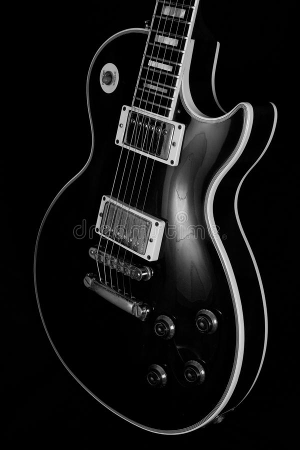 Vintage electric guitar body. Black and white vintage electric guitar body isolated on black background stock photos
