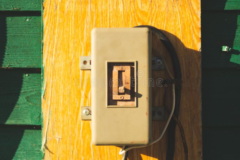 Vintage electrical switch panel. retro power toggle. On the wooden wall, electricity, energy, industry, light, old, cable, contact, control, danger, detail royalty free stock image