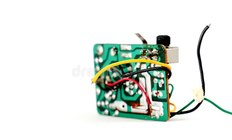 Vintage electronics circuit board with resisters, capacitors,diodes and other components. Image stock photography
