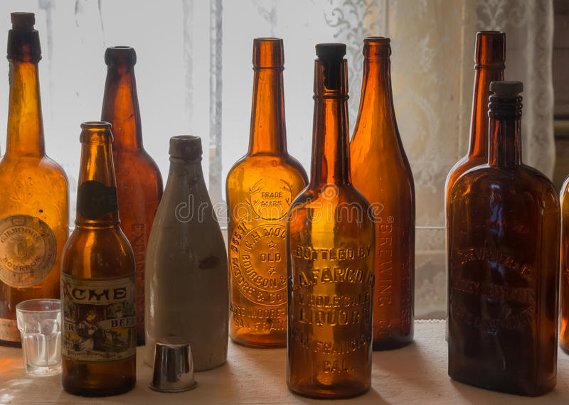 Vintage empty liquor bottles in Bodie State Park, California. USA stock image