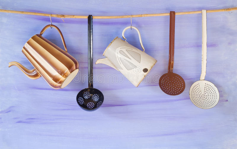 Vintage enamel kitchen utensils royalty free stock photography