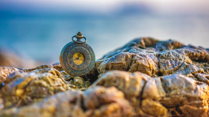 Vintage Engraved Watch On Rock stock photography