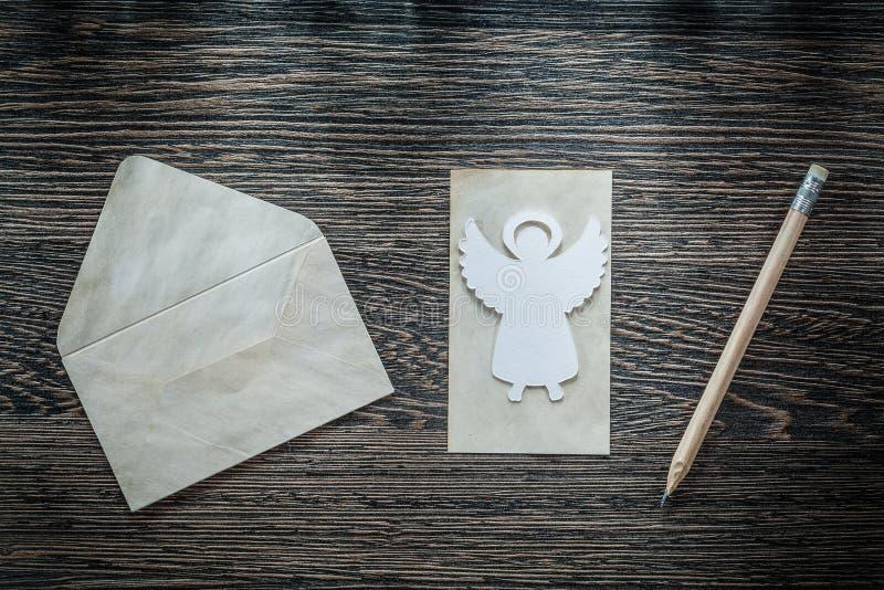 Vintage envelope paper angel pencil on black board stock image