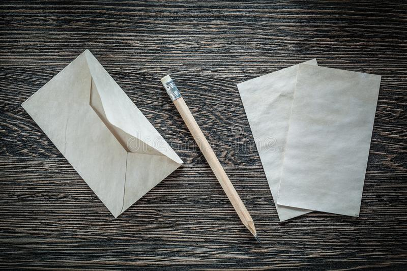 Vintage envelope paper pencil on black board top view royalty free stock photo