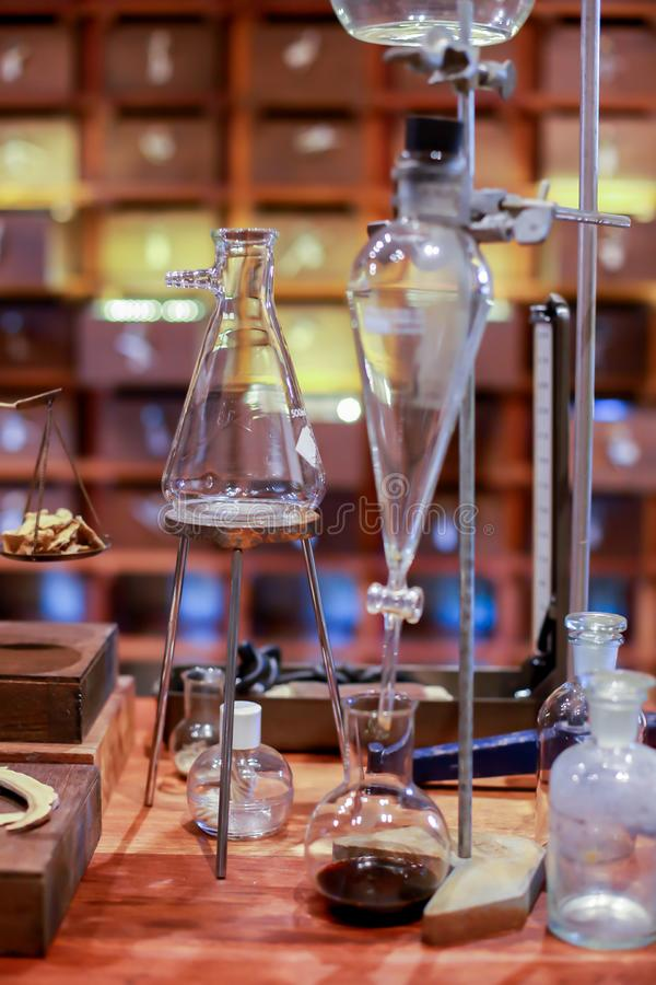 Vintage equipment of chemical laboratory on wooden table. Old pharmacy lab stock photography