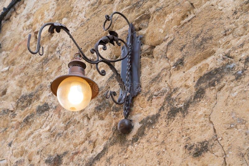 Vintage European design outdoor old school style lantern hanged on street lights building wall royalty free stock photo