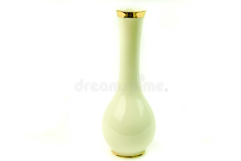 Vintage European porcelain bud vase with gold leaf trim.. Vintage European porcelain china bud vase with gold leaf trim at the top of mouth and bottom of the royalty free stock photo