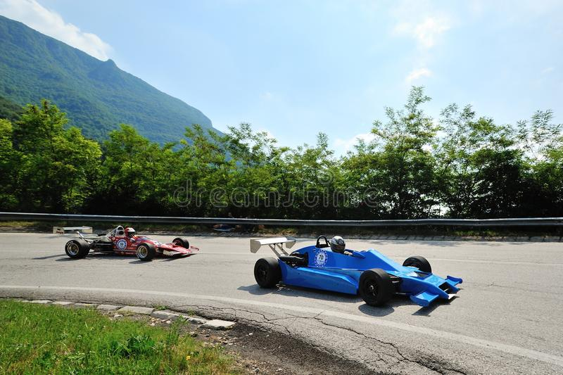 A vintage F3 car followed by a red Formula Ford takes part to the Nave Caino Sant'Eusebio race stock images