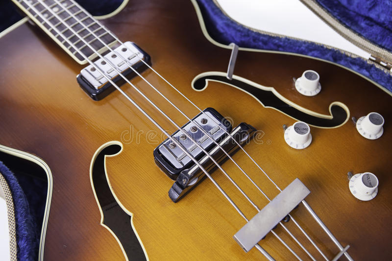 Vintage f-hole semi-acoustic bass guitar stock photos