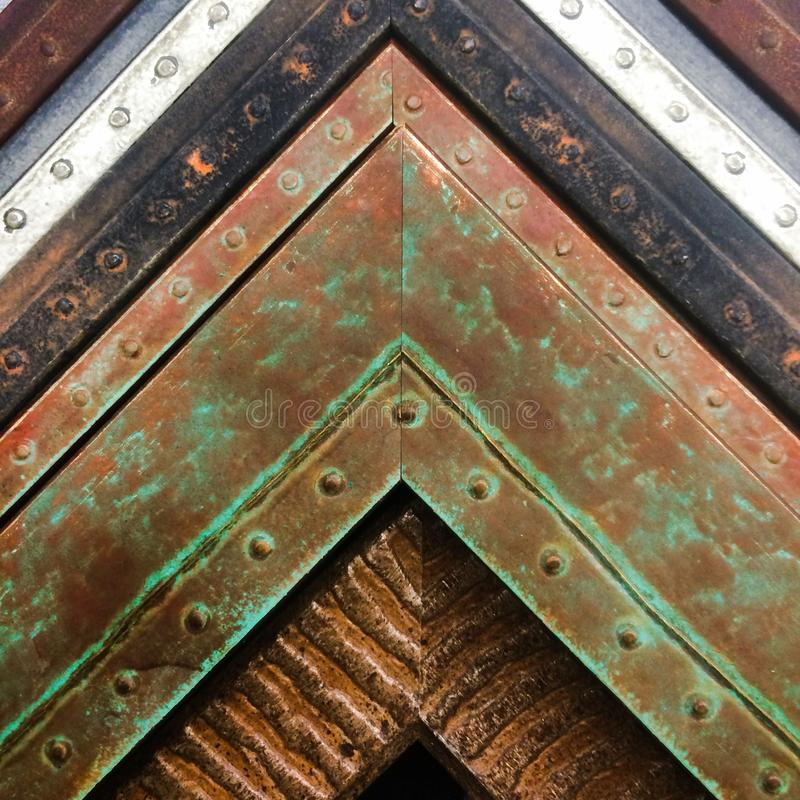 Vintage Rustic Fame Corners. A variety of tarnished faux metal antique frame corners stacked up stock photo