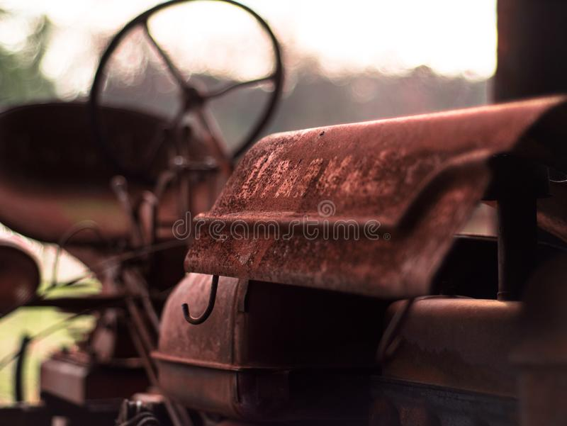 Vintage tractor sitting in a barn royalty free stock images