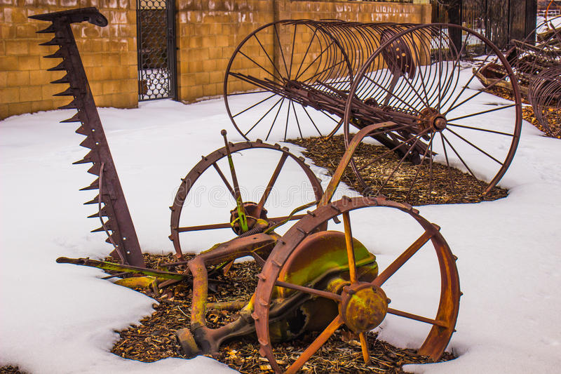 Vintage Farm Equipment In Winter Snow stock photos