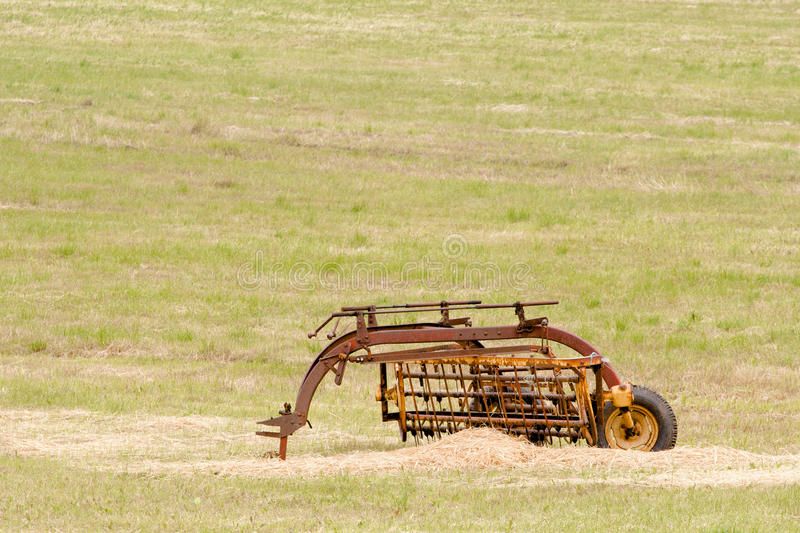 Farm Implement. Vintage farm implement in field stock photo