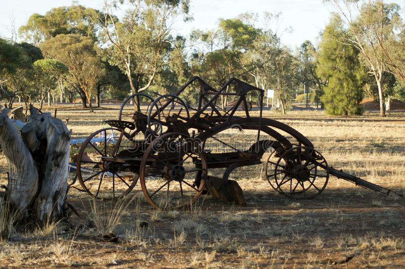 Vintage farm machinery in park stock photos