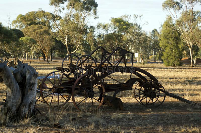 Vintage farm machinery in park royalty free stock photo