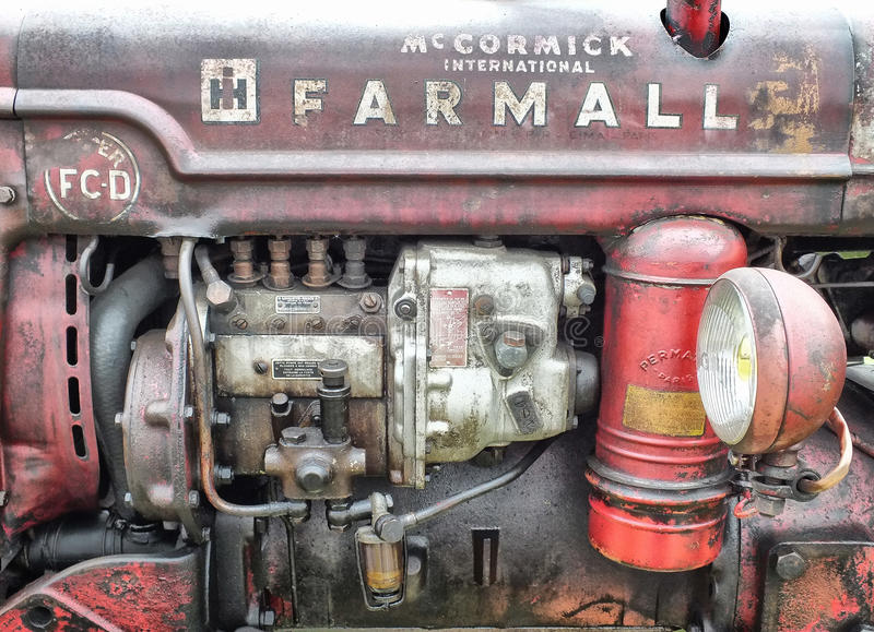 vintage farmall red tractor showing engine details and rust royalty free stock photo