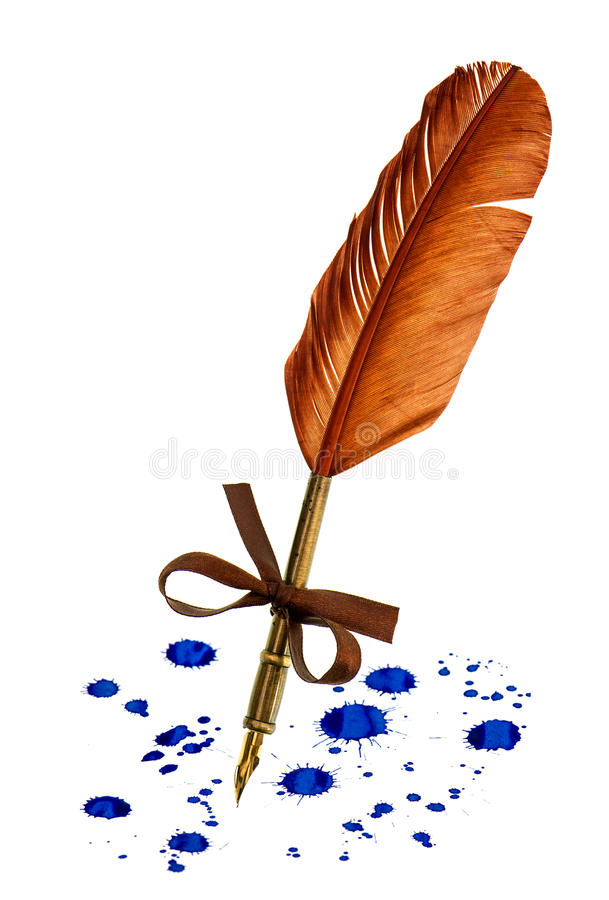 Vintage feather pen with blue ink stains isolated on white royalty free stock images
