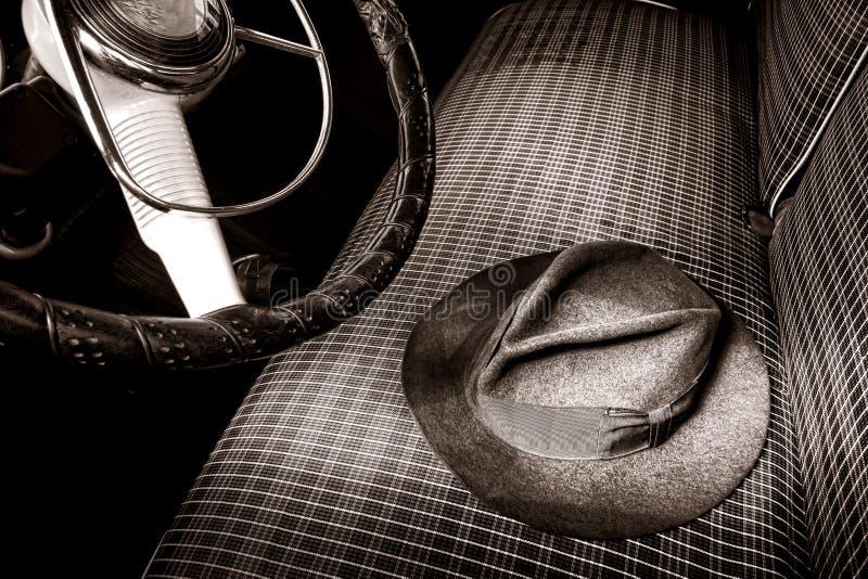 Vintage Fedora Felt Hat on Old Antique Car Seat stock photo