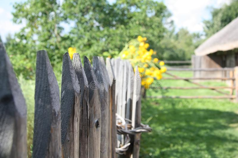 Vintage fence in the `Museum of Belarusian life` near Minsk. royalty free stock photo