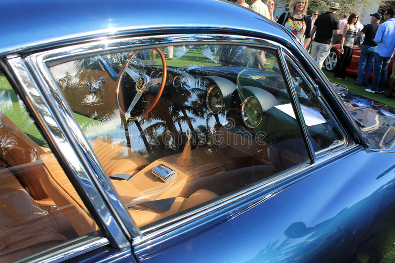 Vintage ferrari sports car window detail. Side window reflections door and view of interior. classic ferrari 250 t lusso high end sports car stock photography