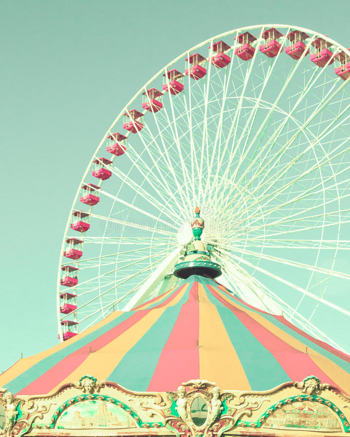 Vintage ferris wheel and carousel tent. In an amusement park stock images
