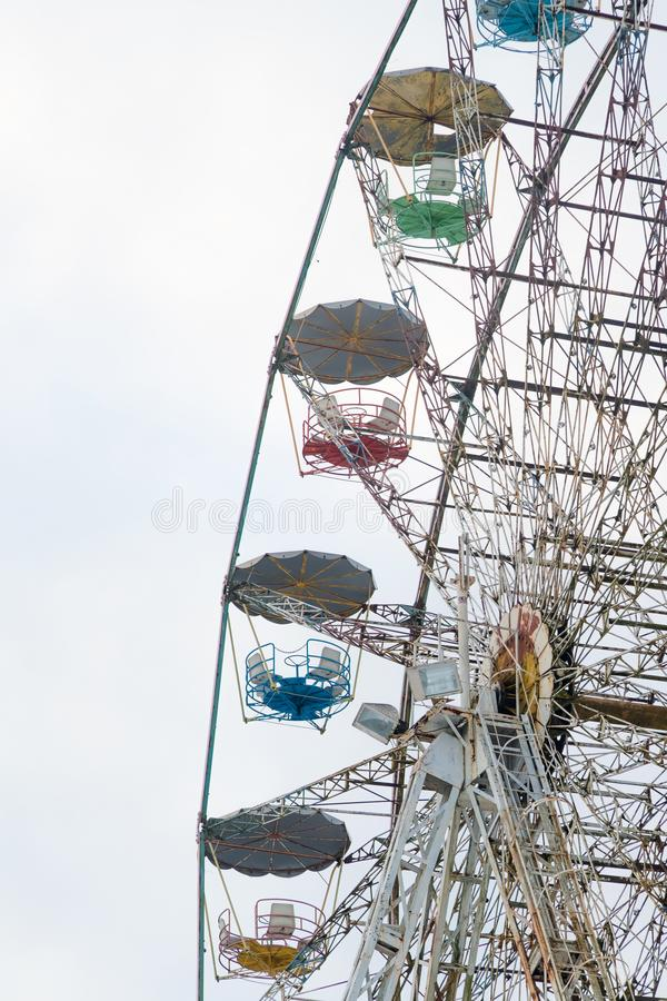 Architectural details of the metallic structure of a big ferris wheel. Old, rustic carousel details at circus outdoor.  royalty free stock photos