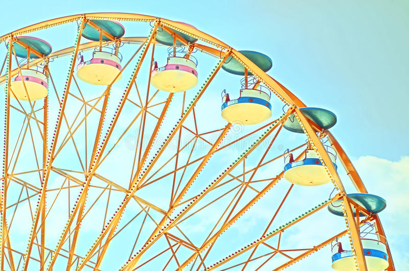 Vintage Ferris Wheel. Over Turquoise Blue Sky stock images